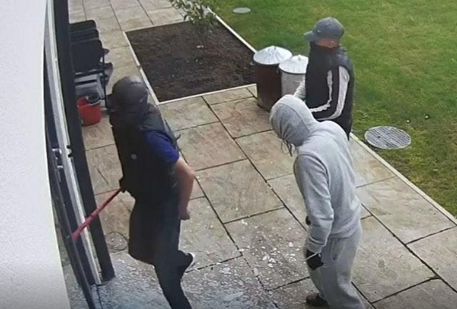 Screen grab from handout footage of Daniel Flynn (sleeveless, left) during a burglary of the home of Cardiff City footballer Sol Bamba