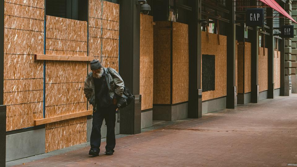 San Francisco, California - April 5th, 2020: Boarded up storefronts and for rent signs have replaced crowds of shoppers in downtown San Francisco during the Covid-19 crisis.