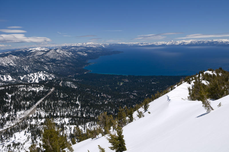 FILE - In this May 26, 2011 file photo is a view of Lake Tahoe near Reno, Nev. California and Nevada officials announced Thursday, April 5, 2012, that they are joining forces in their effort to lure the Winter Games back to the Lake Tahoe area in 2022, forming an exploratory committee to start the process. (AP Photo/Scott Sady, File)