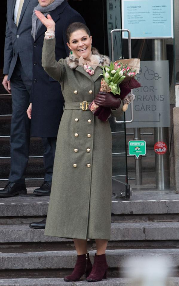 <p>For day one of the Scandinavian royal tour, Crown Princess Victoria of Sweden changed into a sage-hued coat and dress by Stockholm-based designer, Ida Sjostedt. She accessorised the look with co-ordinating burgundy ankle boots and gloves. <em>[Photo: Getty]</em><br /></p>