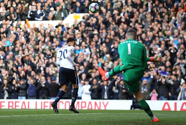 <p>Alli celebrates after beating Forster from 12 yards </p>