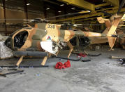 Damaged Afghan military helicopters are seen after the Taliban's takeover inside the Hamid Karzai International Airport in Kabul, Afghanistan, Sunday, Sept. 5, 2021. (AP Photo/Mohammad Asif Khan)