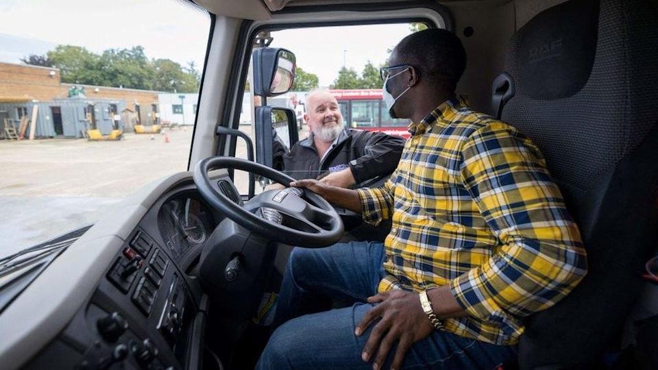 A lorry driver being trained in the UK