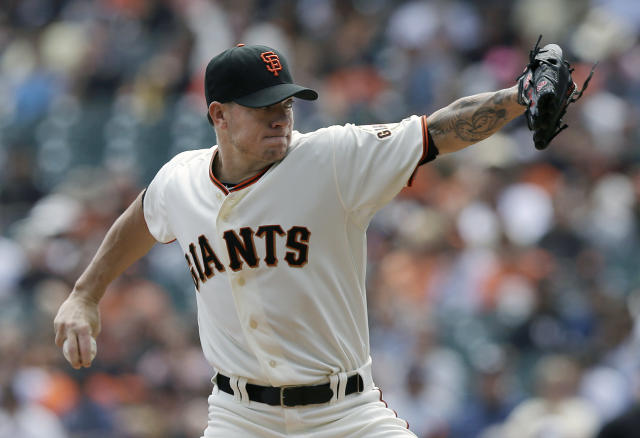 San Francisco Giants pitcher Jake Peavy throws against the Chicago White Sox during the first inning of a baseball game in San Francisco, Calif., Wednesday, Aug. 13, 2014. (AP Photo/Jeff Chiu)