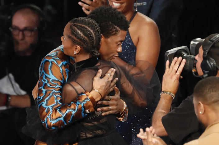 """50th NAACP Image Awards - Show - Los Angeles, California, U.S., March 30, 2019 - Letitia Wright is embraced by Chadwick Boseman after after winning for outstanding breakthrough performance in a motion picture for her role in """"Black Panther."""" REUTERS/Mario Anzuoni"""