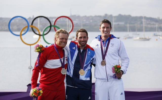 Medallists pose during the men's finn class one person dinghy (heavyweight) sailing medal race victory ceremony at the London 2012 Olympic Games in Weymouth and Portland, southern England August 5, 2012. From L-R: Silver medallist Denmark's Jonas Hogh-Christensen, gold medallist Britain's Ben Ainslie and bronze medallist France's Jonathan Lobert. REUTERS/Pascal Lauener (BRITAIN - Tags: SPORT YACHTING OLYMPICS)