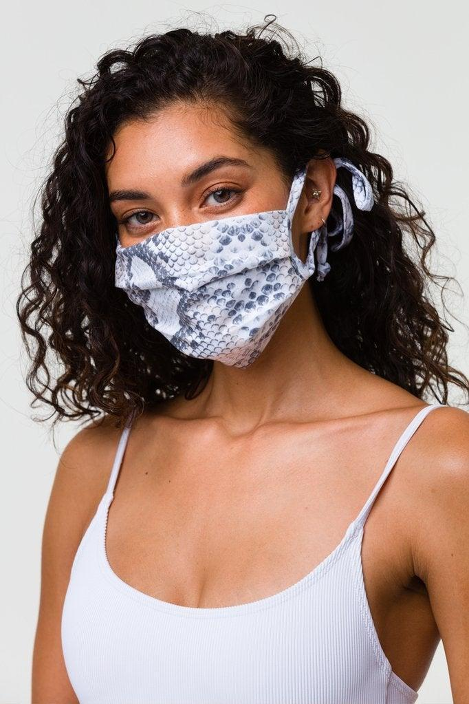 """<br><br><strong>Onzie</strong> Mindful Masks Cotton Flow - Anaconda/Prey, $, available at <a href=""""https://go.skimresources.com/?id=30283X879131&url=https%3A%2F%2Fwww.onzie.com%2Fcollections%2Fmindful-masks%2Fproducts%2Fmindful-masks-cotton-flow-anaconda-prey"""" rel=""""nofollow noopener"""" target=""""_blank"""" data-ylk=""""slk:Onzie"""" class=""""link rapid-noclick-resp"""">Onzie</a>"""