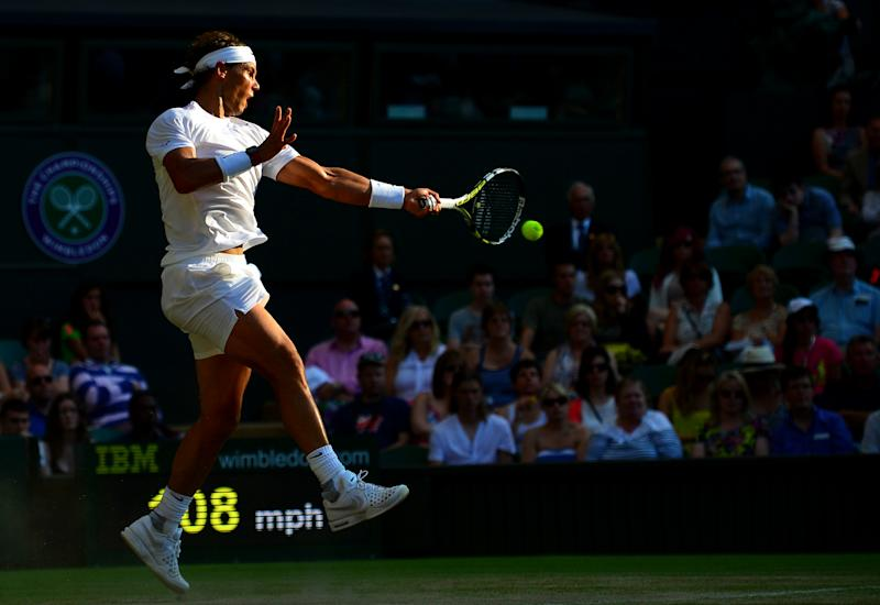 Spain's Rafael Nadal returns against Australia's Nick Kyrgios during their men's singles fourth round match on day eight of the 2014 Wimbledon Championships at The All England Tennis Club in Wimbledon, southwest London, on July 1, 2014