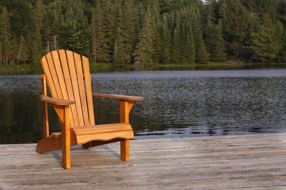 <p>A signature of American vacation homes, the Adirondack chair traces its roots back to 1903 in Westport, New York, where Thomas Lee created a simple wood design sturdy enough to keep sitters upright on hilly terrain. Today, the classic wood model shares the market with injection-molded plastic versions.</p>
