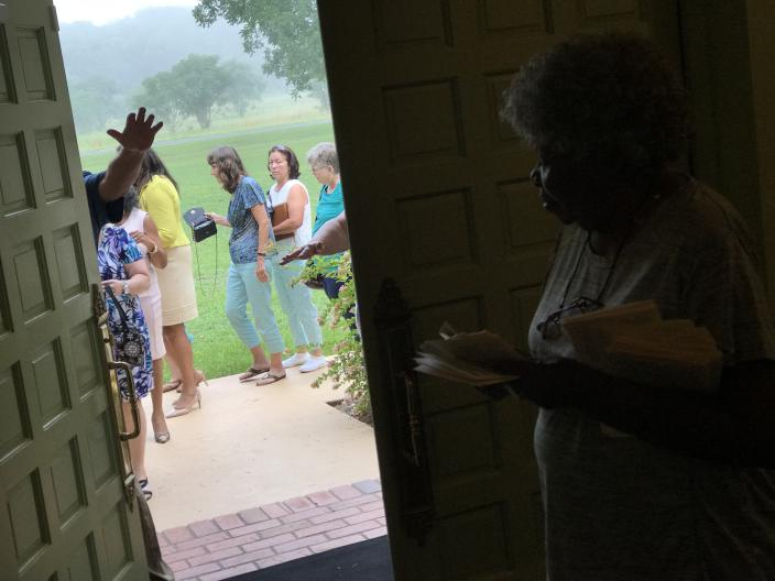 Mary Prince, a resident of Plains since 1981, holds church service programs and waits for visitors to be screened by Secret Service agents at the door of Maranatha Baptist Church, before entering to see former President Jimmy Carter teach Sunday school. Carter has continued to teach twice a month despite battling brain cancer that was diagnosed in 2015 and is now in remission. He was out less than a month earlier this year after he broke his hip. (Photo: Jon Ward/Yahoo News)
