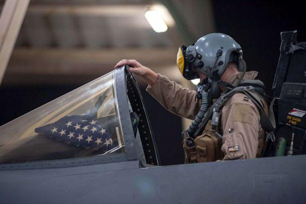 PHOTO: A pilot works in the cockpit at a U.S. military site. (U.S. Air Force)