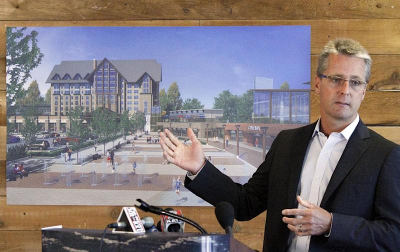 Jeff Parr, co-CEO of Clairvest Group, Inc., unveils a new casino complex his group wants to build in Wood Village, Ore., Thursday, Aug. 23, 2012. Developers who want to build Oregon's first non-tribal casino hope to convince voters to approve the gaming center in November.(AP Photo/Don Ryan)