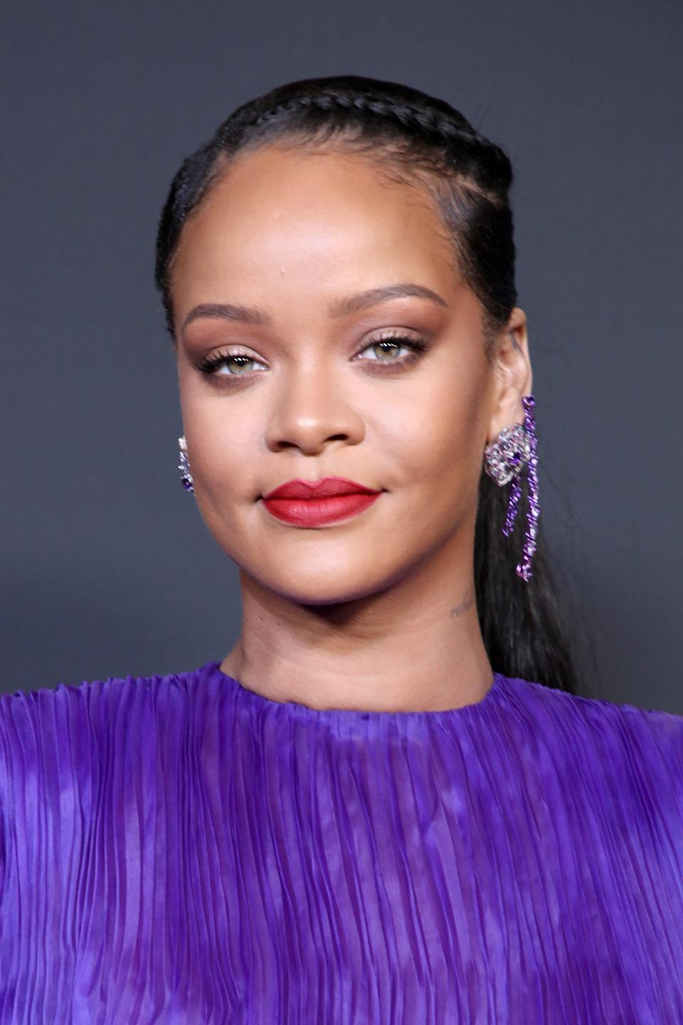 Rihanna is coming under fire for wearing a necklace depicting a Hindu god in her latest sultry Instagram post.