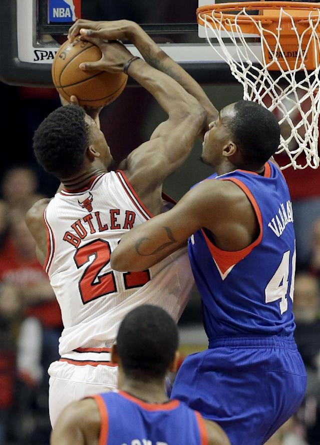 Philadelphia 76ers forward Jarvis Varnado (40), right, blocks a shot by Chicago Bulls guard Jimmy Butler (21) during the first half of an NBA basketball game in Chicago on Saturday, March 22, 2014. (AP Photo/Nam Y. Huh)