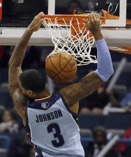 Memphis Grizzlies' James Johnson dunks during the second half of an NBA basketball game against the Milwaukee Bucks, Wednesday, Jan. 15, 2014, in Milwaukee. (AP Photo/Morry Gash)