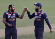 India's Virat Kohli, right, gestures with teammate Mohammed Shami during the one day international cricket match between India and Australia at the Sydney Cricket Ground in Sydney, Australia, Friday, Nov. 27, 2020. (AP Photo/Rick Rycroft)