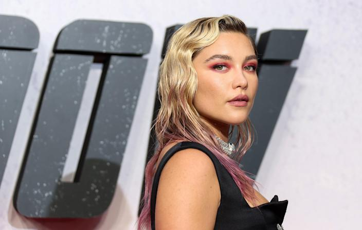 """Florence Pugh's current color also offers up another low-key take on magenta hair. The actor only added hints of pink to her ends, and for a recent movie premiere, she even matched her makeup to <a href=""""https://www.allure.com/gallery/best-magenta-makeup-tips?mbid=synd_yahoo_rss"""" rel=""""nofollow noopener"""" target=""""_blank"""" data-ylk=""""slk:the dynamic hue"""" class=""""link rapid-noclick-resp"""">the dynamic hue</a>."""