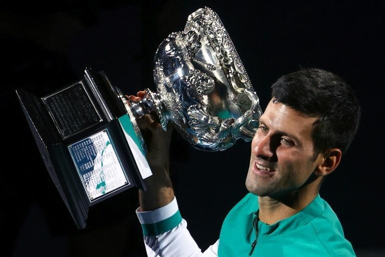 Novak Djokovic lifts the Norman Brookes Challenge Cup for the ninth time