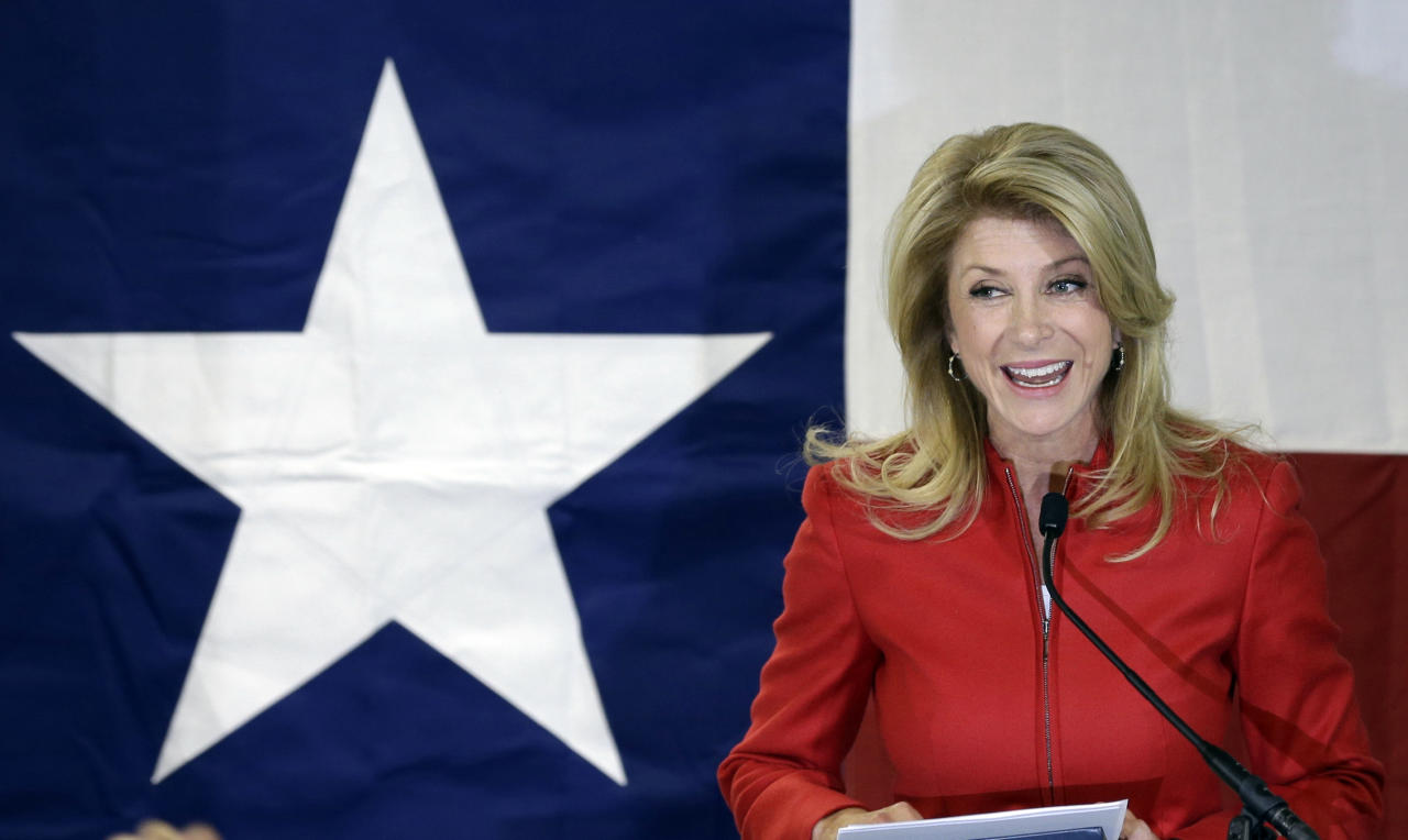 File - In this March 4, 2014 file photo, Texas Sen. Wendy Davis, D-Fort Worth, speaks to supporters at her campaign headquarters, in Fort Worth, Texas. Davis' compelling personal story of rising from a trailer park to Harvard Law has reeled in donors. She now has financial backers in every U.S. state. (AP Photo/LM Otero, File)