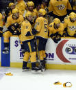 Nashville Predators left wing Filip Forsberg (9), of Sweden, celebrates with teammates after scoring his third goal against the Columbus Blue Jackets for a hat trick during the third period of an NHL hockey game Saturday, April 7, 2018, in Nashville, Tenn. (AP Photo/Mark Zaleski)