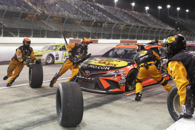 Martin Truex Jr. makes a pit stop during the NASCAR Cup Series auto race Wednesday, May 20, 2020, in Darlington, S.C. (AP Photo/Brynn Anderson)