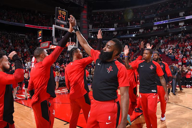 HOUSTON, TX - APRIL 7: James Harden #13 of the Houston Rockets high fives his teammates before the game against the Phoenix Suns on April 7, 2019 at the Toyota Center in Houston, Texas. NOTE TO USER: User expressly acknowledges and agrees that, by downloading and/or using this photograph, user is consenting to the terms and conditions of the Getty Images License Agreement. Mandatory Copyright Notice: Copyright 2019 NBAE (Photo by Bill Baptist/NBAE via Getty Images)