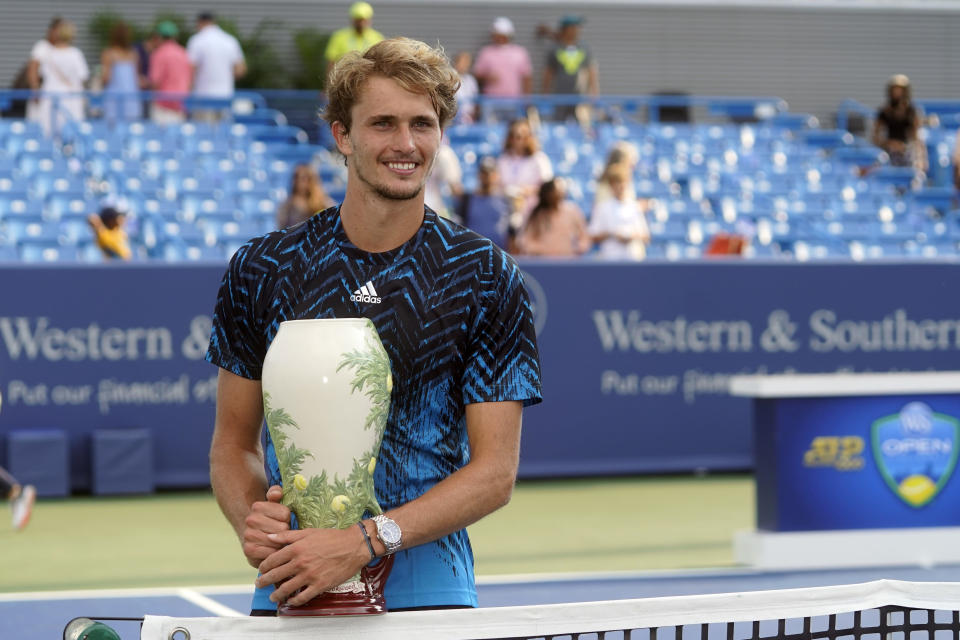 Alexander Zverev, of Germany, holds the trophy after defeating Andrey Rublev, of Russia, in the men's single final of the Western & Southern Open tennis tournament, Sunday, Aug. 22, 2021, in Mason, Ohio. (AP Photo/Darron Cummings)