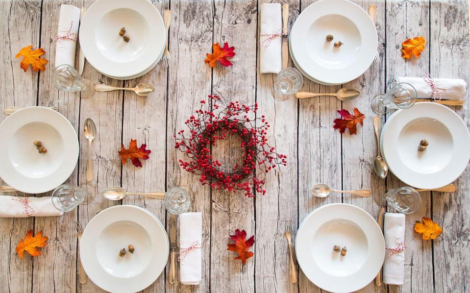 """<p>Follow the """"less is more"""" approach by letting an understated berry wreath take center stage on your fall table. </p>"""