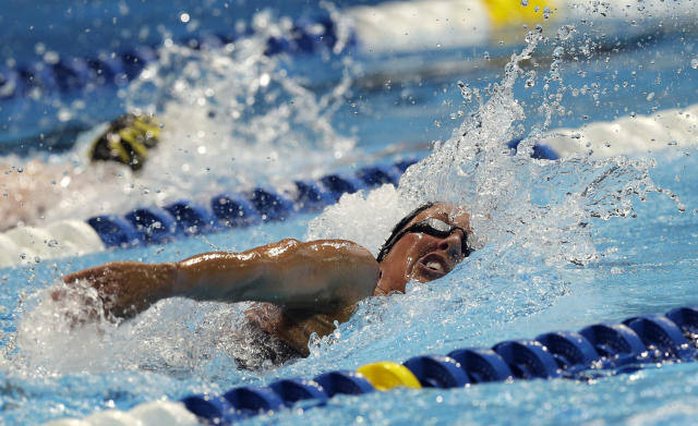 Janet Evans swims in the women's 400-meter freestyle preliminaries at the U.S. Olympic swimming trials, Tuesday, June 26, 2012, in Omaha, Neb. (AP Photo/David J. Phillip)