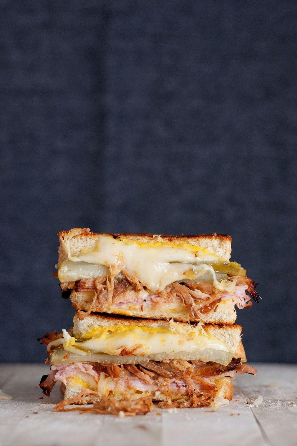 """<p>Yes, a Cuban sandwich counts in your all-grilled cheese diet. </p><p>Get the recipe from <a href=""""http://bsinthekitchen.com/the-cuban-grilled-cheese/#more-3859"""" rel=""""nofollow noopener"""" target=""""_blank"""" data-ylk=""""slk:BS' In The Kitchen"""" class=""""link rapid-noclick-resp"""">BS' In The Kitchen</a>.</p>"""