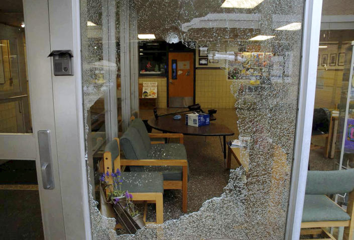 This December 2012 photo released by the Connecticut State Police on Friday, Dec. 27, 2013, shows a shattered window at Sandy Hook Elementary School in Newtown, Conn. Adam Lanza gunned down 20 first-graders and six educators with a semi-automatic rifle at the school on Dec. 14, 2012, after killing his mother inside their home. Lanza committed suicide with a handgun as police arrived at the school. (AP Photo/Connecticut State Police)