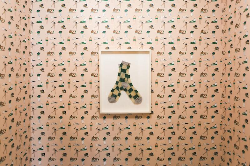 The sock artwork is made from Vaux Vintage socks and frames by Walnut Hill Fine Art (note to self: Do this at home). The laundromat collaborated with Al Stampa to design this custom wallpaper called Cycles.