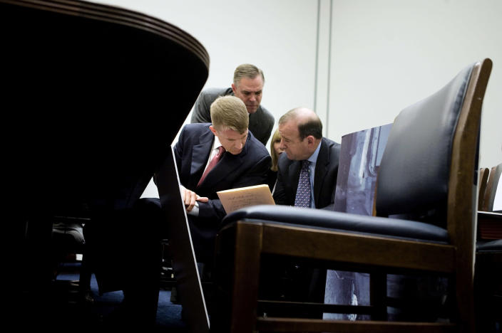Erik Prince, left, confers with attorney Stephen Ryan while testifying before the House Oversight and Reform committee in Washington on Oct. 2, 2007, about the incident where Blackwater contractors killed 17 Iraqi civilians. (Brendan Smialowski/The New York Times)
