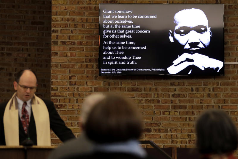 In this Jan. 17, 2020, photo Rabbi Fred Reeves, left, speaks during the Friday Shabbat Service at KAM Isaiah Israel in Chicago. On the eve of the day set aside to honor an African American who strove against hate and preached racial and social justice, some worry the nation is becoming more divided. (AP Photo/Nam Y. Huh)