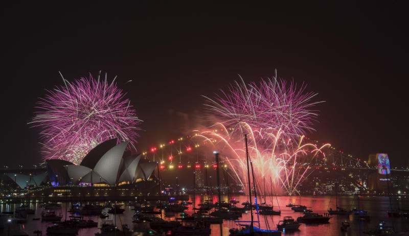 Fireworks explode over the Sydney Harbour during the New Year's Eve celebrations in Sydney