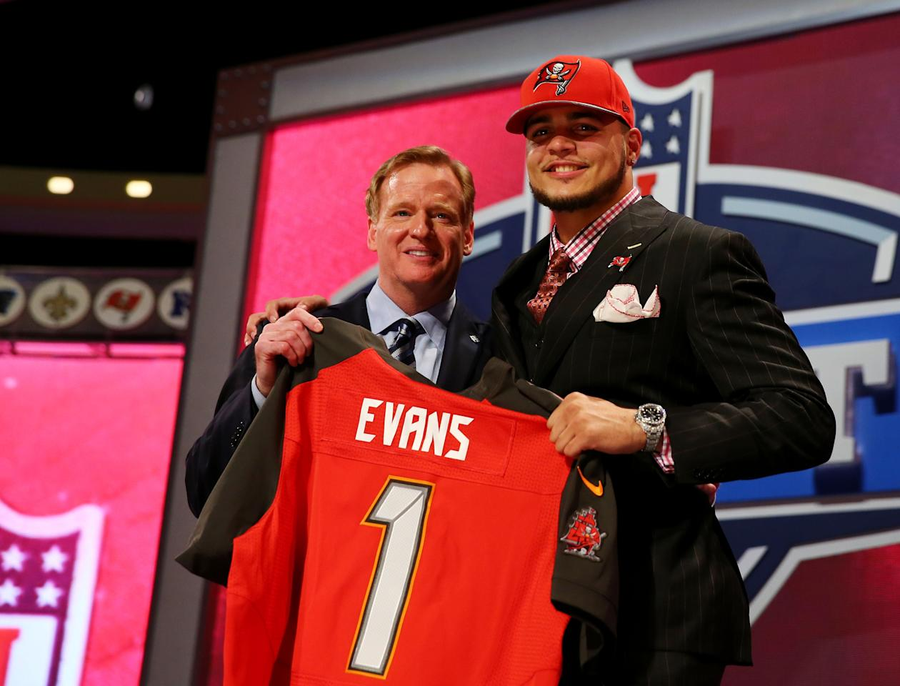 NEW YORK, NY - MAY 08: Mike Evans of the Texas A&M Aggies poses w NFL Commissioner Roger Goodell after he was picked #7 overall by the Tampa Bay Buccaneers during the first round of the 2014 NFL Draft at Radio City Music Hall on May 8, 2014 in New York City. (Photo by Elsa/Getty Images)
