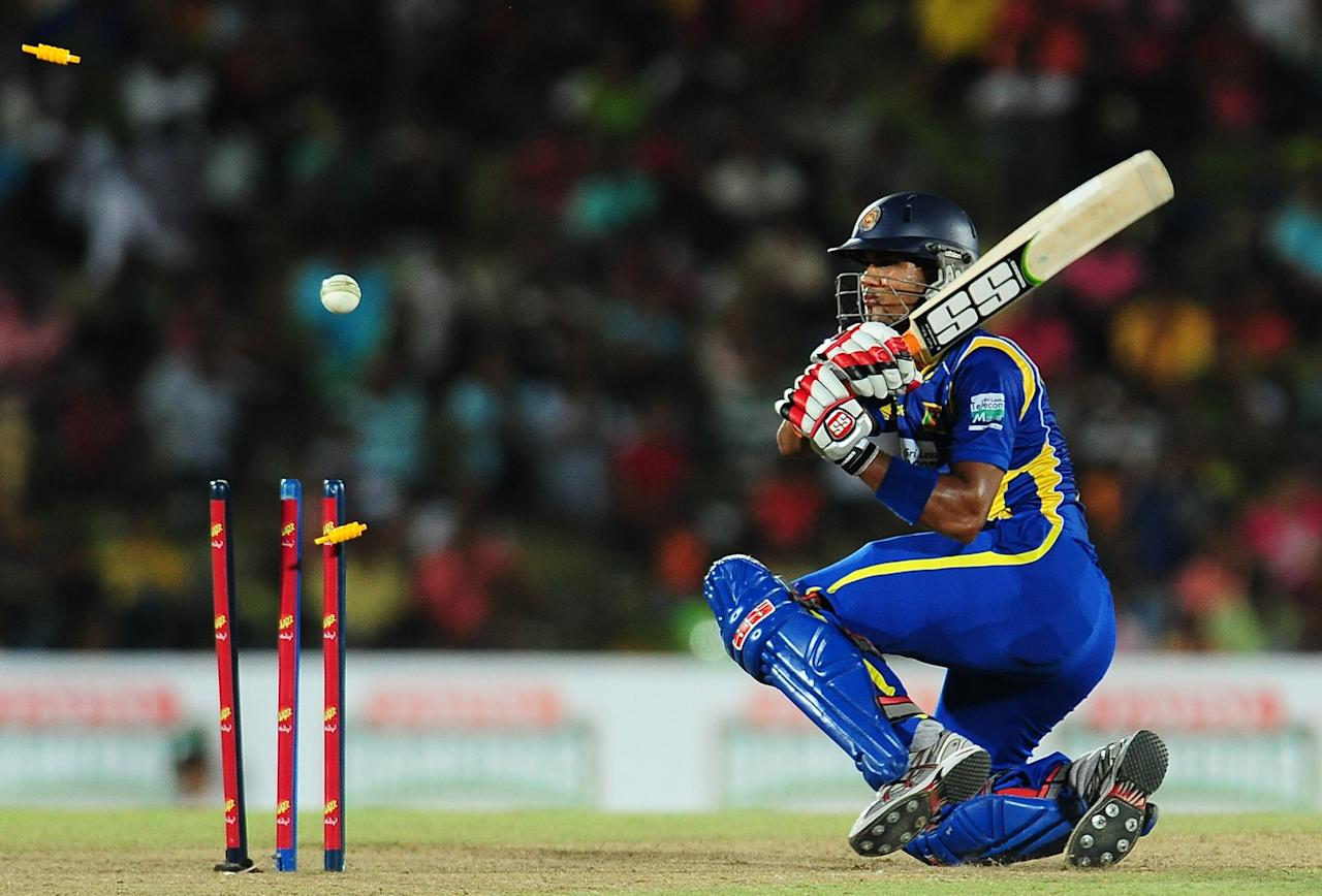 Sri Lanka's cricketer Dinesh Chandimal gets dismissed during the second and final Twenty20 match between Sri Lanka and Pakistan at the Mahinda Rajapaksa International Cricket Stadium in the southern district of Hambantota on June 3, 2012. AFP PHOTO/ LAKRUWAN WANNIARACHCHI