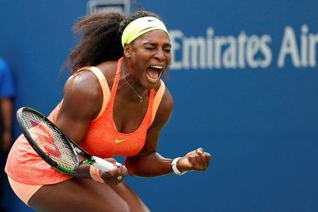 Serena Williams of the United States reacts after winning the first set against Kiki Bertens of the Netherlands (not pictured) on day three of the 2015 U.S. Open tennis tournament at USTA Billie Jean King National Tennis Center. Geoff Burke-USA TODAY Sports