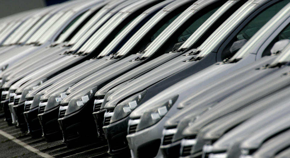 A row Vauxhall Astra cars stand outside the Vauxhall plant at Ellesmere Port near Liverpool, northern England on May 16, 2006. Vauxhall's parent company, General Motors, is expected to announce cutbacks to the workforce at the Ellesmere Port plant.  REUTERS/Phil Noble