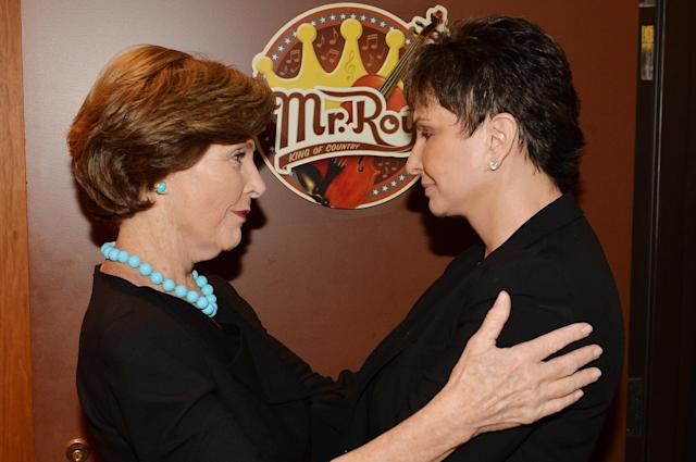 NASHVILLE, TN - MAY 02: (EXCLUSIVE COVERAGE) Former US First Lady Laura Bush (L) and Nancy Jones attend the funeral service for George Jones at The Grand Ole Opry on May 2, 2013 in Nashville, Tennessee. Jones passed away on April 26, 2013 at the age of 81. (Photo by Rick Diamond/Getty Images for GJ Memorial)