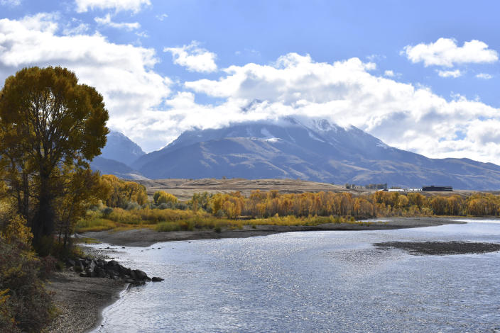 FILE - In this Oct. 8, 2018, file photo, Emigrant Peak is seen rising above the Paradise Valley and the Yellowstone River near Emigrant, Mont. The Biden administration has nominated a longtime environmental advocate and Democratic aide, Tracy Stone-Manning, to oversee roughly 250 million acres of public lands as director of the Bureau of Land Management. (AP Photo/Matthew Brown, File)
