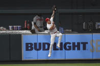 St. Louis Cardinals left fielder Tyler O'Neill jumps at the wall and catches a fly ball hit by Atlanta Braves' Adam Duvall during the eighth inning of a baseball game Tuesday, Aug. 3, 2021, in St. Louis. (AP Photo/Joe Puetz)
