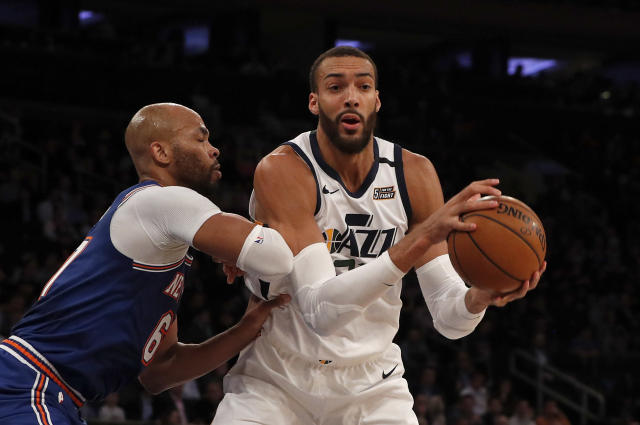Rudy Gobert of the Utah Jazz in action against Taj Gibson of the New York Knicks. (Photo by Jim McIsaac/Getty Images)