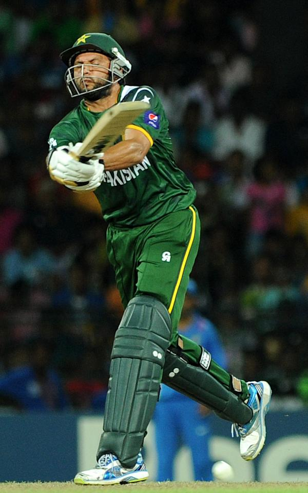 Pakistan cricketer Shahid Afridi plays a shot during the ICC Twenty20 Cricket World Cup's Super Eight match between India and Pakistan at The R. Premadasa International Cricket Stadium in Colombo on September 30, 2012.  AFP PHOTO / Ishara S.KODIKARA