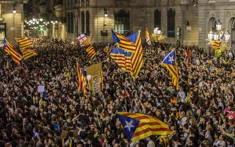 Pro-independence supporters celebrate following the parliamentary vote - Credit: Angel Garcia/Bloomberg
