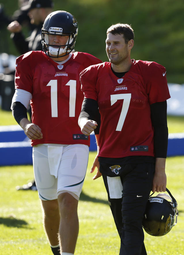 Jacksonville Jaguars' quarterback Chad Henne, right, and quarterback Blaine Gabbert take part in their football practice at the Pennyhill Park Hotel and Spa in Bagshot, England, Wednesday, Oct. 23, 2013. The Jaguars face the San Francisco 49ers on Sunday in a NFL football game at Wembley Stadium in London. (AP Photo/Sang Tan)