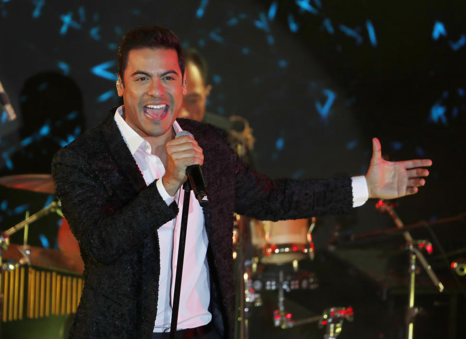 Mexican singer-songwriter Carlos Rivera performs during an edition of the Latin Grammy Acoustic Sessions at the Soumaya Museum, in Mexico City, Wednesday, May 22, 2019. (AP Photo/Marco Ugarte)