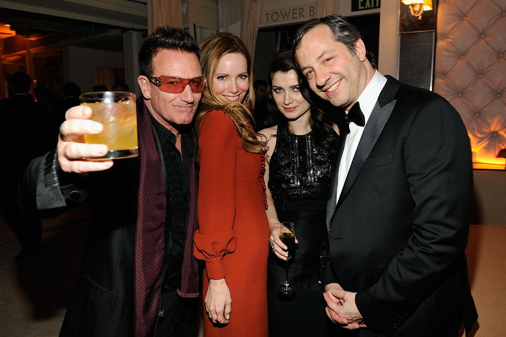 Bono, Eve Hewson, Leslie Mann, and Judd Apatow attend the 2013 Vanity Fair Oscar Party hosted by Graydon Carter at Sunset Tower on February 24, 2013 in West Hollywood, California.