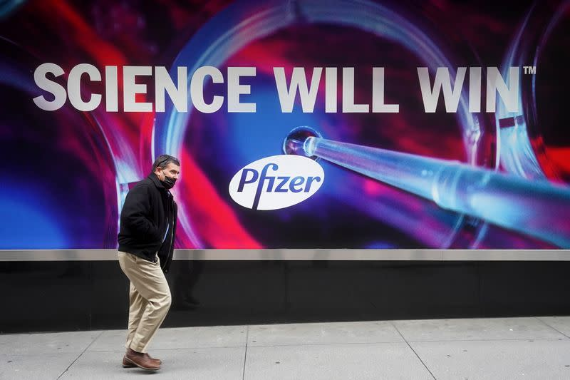 A person walks past the Pfizer Headquarters building in New York City