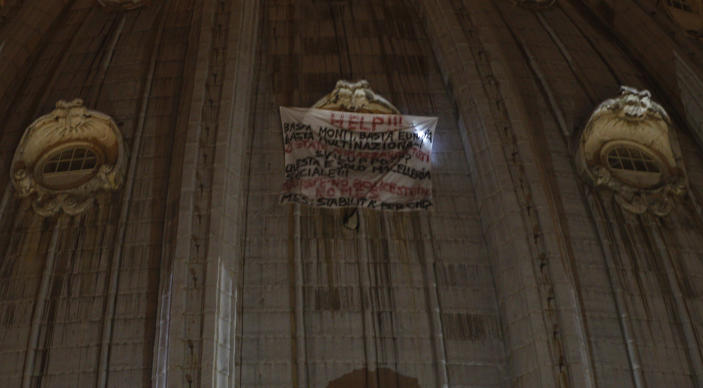 A banner hangs from a window of St. Peter's dome at the Vatican, Tuesday, Oct. 2, 2012. (AP Photo/Alessandra Tarantino)